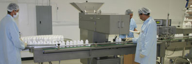 The Acai Bottles Are Passed Through A Labeling Machine.